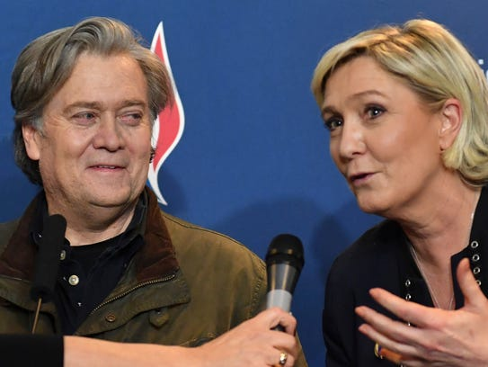 National Front party leader Marine Le Pen, right, and