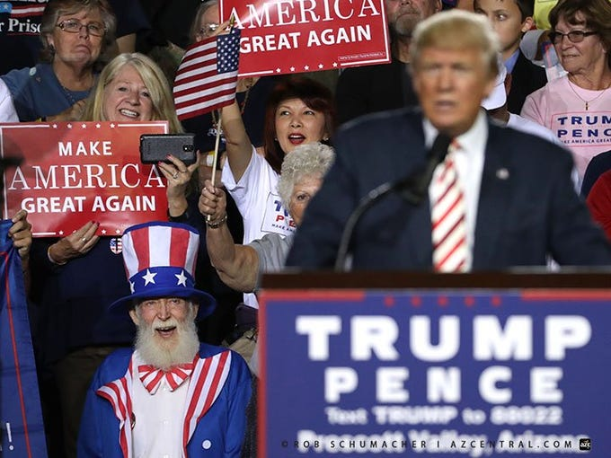 Uncle Sam in the front row as Donald Trump holds a