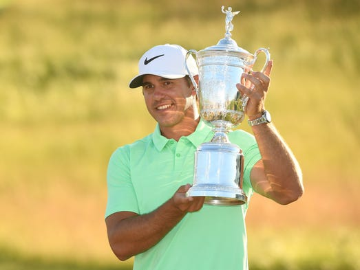 Brooks Koepka celebrates his first career major championship