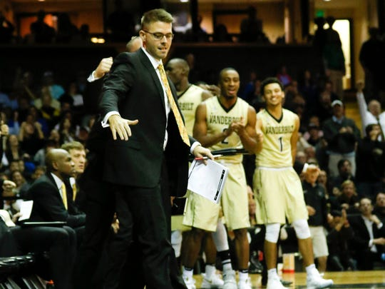 Vanderbilt guard Riley LaChance (13) lays on the ground