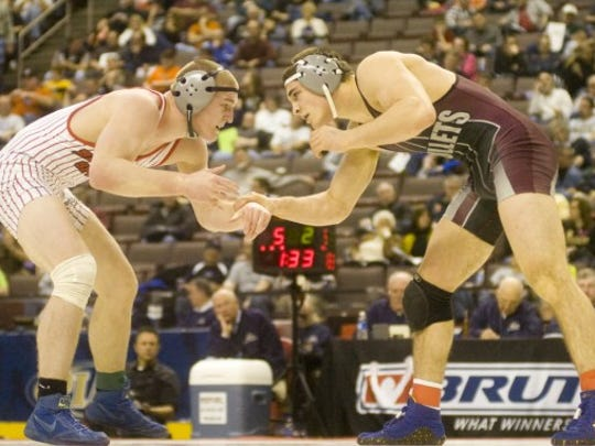Bermudian Springs' Tristan Sponseller, left, goes up against Brandywine Heights Pete Renda during last season's PIAA 170-pound wrestling championship in Class AA. Sponseller returns for the Eagles and is expected to wrestle at 182 pounds. (GAMETIMEPA.COM -- FILE)