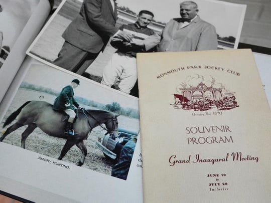 Some family memorabilia belonging to Hope Haskell Jones, including a program from Monmouth Park's opening season in 1946, at her home in Little Silver. She is the daughter of Amory L. Haskell, one of Monmouth Park's founders, with the 50th Haskell Invitational, named after her father, to be run on Sunday.