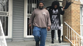 Pete Kimber stands on the porch of the Sherman Park home he and his family bought with the help of a program aimed at fighting blight and preventing foreclosures in the city. Keisha Krumm (right) of Common Ground worked with the city and Ocwen Financial Corp as part of the program.