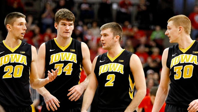 Iowa Hawkeyes forward Jarrod Uthoff (20), center Adam Woodbury (34), guard Josh Oglesby (2) and forward Aaron White (30) during the Hawkeyes 71-65 win over the Ohio State Buckeyes at Value City Arena.
