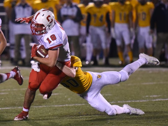 Canton senior running back Reid McDonnell tries to elude the grasp of a Saline defender Friday night.