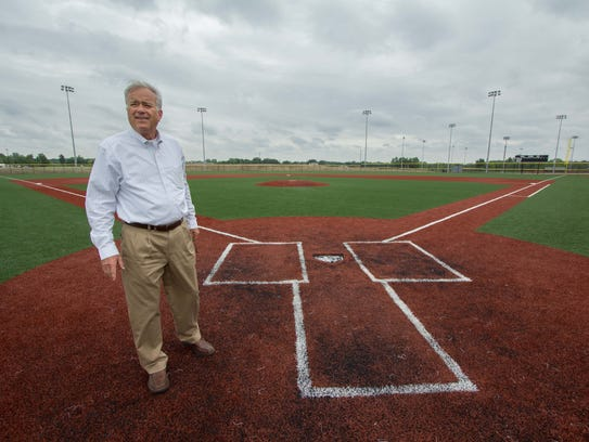 Westfield Mayor Andy Cook stands near home plate on