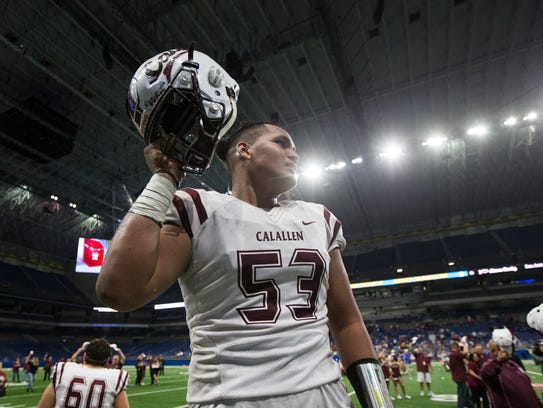Calallen's Kenese Leomiti celebrates after their victory over Kerrville Tivy during their Class 5A Division II regional semifinal game Saturday, Dec. 2, 2017, at the Alamodome in San Antonio.