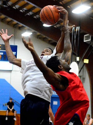 James Brooks of Weber Inc., left,  grabs a rebound from Greg Carroll of Showtime during the York Summer Basketball Division I championships at Voni Grimes Gym in 2015. York County boasts several adult basketball programs. One of those programs, operated by York Township, has been suspended because of financial issues.