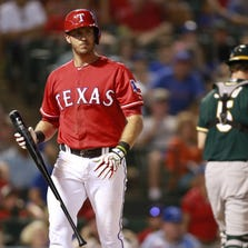 Jul 26, 2014; Arlington, TX, USA; Texas Rangers first baseman J.P. Arencibia (7) reacts after striking out in the sixth inning against the Oakland Athletics at Globe Life Park in Arlington. Mandatory Credit: Tim Heitman-USA TODAY Sports