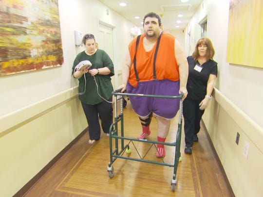"Robert Buchel of Forked River walks with his fiancee, Kathryn, on TLC's ""My 600-Lb Life."""