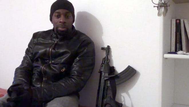 This screengrab taken on Jan. 11 from a video released on Islamist social networks shows a man claiming to be Amedy Coulibaly, who is suspected of killing a policewoman in Montrouge on Jan. 8 and four hostages after seizing a kosher supermarket in Paris.