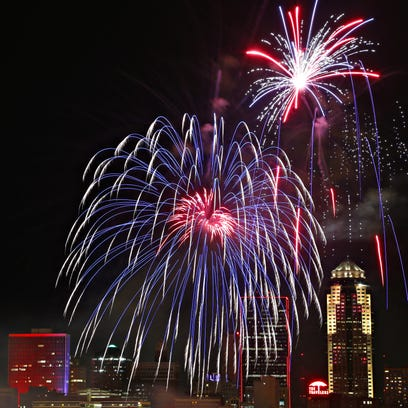 Fireworks explode over the Des Moines sky line closing