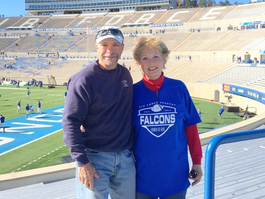 Al and Marti Santos enjoy some football time at Falcon Stadium.