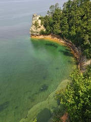 An aerial view of Miner's Castle at the Pictured Rocks National Lakeshore along Lake Superior in the Upper Peninsula. The colorful sandstone formations at Pictured Rocks are one of Michigan's gems.