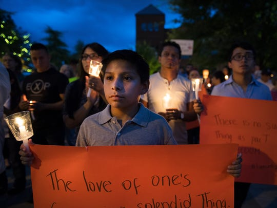 Giovanny Samtillan, 11, attends a vigil for Dreamers in response to Trump's announcement to end DACA outside of the Peace Center in Greenville on Tuesday, September 5, 2017.