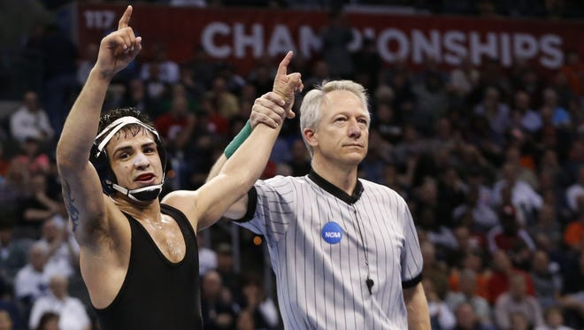 Former Iowa wrestler Tony Ramos is an NCAA champion and a World Championships qualifier. But the 24-year-old also specializes in marketing and moonlights in business. His online store sells T-shirts, socks, bumper stickers and headphones bearing his logo.