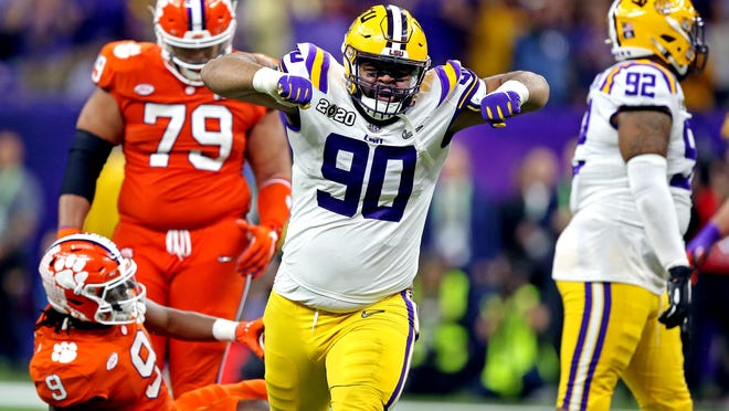 LSU defensive lineman Rashard Lawrence (90) reacts after a play against Clemson.