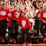 Nebraska players react seconds after the NCAA Selection Show announced ther team's spot in the NCAA tournament bracket on March 16, 2014.