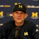 Harbaugh's return to recruiting 'pretty much the same'