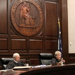 S.C. Supreme Court Chief Justice Jean Toal, second from right, makes a point inside the courtroom in this June 24, 2014 photo.