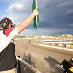 Matt Mann directs the cars at the Electric City Speedway in action last year at the track.