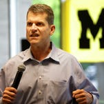 Metro Detroit high school football coaches listen to U-M coach Jim Harbaugh during the Michigan Football Clinic at the Horatio Williams Foundation building in Detroit on Wednesday, May 27, 2015.