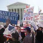 Protesters and supporters of same-sex marriage stand on the steps of the U.S. Supreme Court in Washington, D.C., April 28.