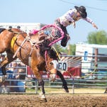 Brandon Toren of Fort Shaw is thrown off his horse at the Choteau Rodeo on July 4, 2015.