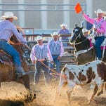Dakota Eldridge of Elko, Nev., leaves his horse to wrestle a steer to the ground in 5.9 seconds during the PRCA rodeo at the state fair on Thursday.