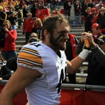 Iowa linebacker Bo Bower high-five's fans following the Hawkeyes' 10-6 win over Wisconsin at Camp Randall in Madison on Saturday, Oct. 3, 2015.
