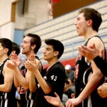 The North Salem bench celebrates a play in the first half of the North Salem vs. South Salem boy's basketball game at South Salem High School on Tuesday, Jan. 20, 2015. South Salem won the game 65-32.