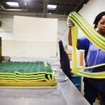 Twana Thomas of Detroit works in the fabrication department of Armaly Brands in Walled Lake, Mich., on Dec. 10.   REGINA H. BOONE/DETROIT FREE PRESS