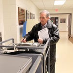 Mike Cavanaugh submits his ballot at Horn Elementary on Tuesday, Jan. 19, 2016.