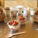 A variety of Yotopia's GreekYo is pictured with its granola on Tuesday, Feb. 2, 2016.
