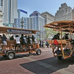Teams race in the HandleBar Hot Lap on Monument Circle, Friday, May 6, 2016.  In the spirit of the 100th Running of the Indy 500, HandleBar, Downtown Indy, Inc. and the Indianapolis Motor Speedway hosted the 100th Running HandleBar Hot Lap. Races include one-on-one laps with a 24-team single elimination bracket, narrowing down Indy's best, culminating in a championship race between the top two teams.