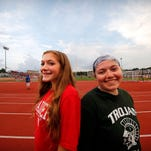 Abby Chiesa (left) and her sister Emily are seen while the two attended the Wauwatosa East versus West football game in Hart Park Friday, Aug. 19, 2016, in Wauwatosa, Wisconsin. Abby attends East and Emily West.