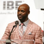 FILE -- Indianapolis Colt Reggie Wayne presents the Spirit Award to coach Chuck Pagano during the Indiana Black Expo's corporate luncheon at the Indiana Convention Center, Friday, July 15, 2016.