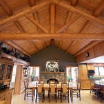 House Envy: Cedar logs inside and out give 6-bedroom Northville home a woodsy feel