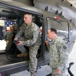 Aircraft mechanic Ryan Richard, center, demonstrates the thermal imaging camera on a new UH-72A Lakota helicopter for the media as Col. Greg Hapgood, right, Iowa National Guard public affairs officer, looks on at the Iowa Army National Guard Air Aviation Support Facility Thursday in Waterloo.