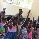Mitch Albom visits Haita on earthquake anniversary
