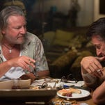"Ray Winstone, left, and Sean Penn in ""The Gunman,"" a new action thriller."