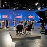 The Republican candidates for state superintendent of education participate in a debate on South Carolina ETV, May 27, 2014, in Columbia. Behind the podiums from left are, Sally Atwater, Sheri Few, Elizabeth Moffly, Gary Burgess, moderator Charles Bierbauer, Molly Spearman, Don Jordan, Amy Cofield and Meka Childs.