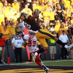 Iowa wide receiver Derrick Willies pulls in a pass in the end zone during the Hawkeyes' game against Ball State at Kinnick Stadium earlier this season. According to an Instagram credited to Willies, the freshman wide receiver is apparently leaving the Hawkeyes' football team.