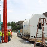 A 42-ton 7 Tesla magnet is prepped to be moved to the Pappajohn Biomedical Discovery Building on Thursday, June 5, 2014. The magnetic resonance imaging (MRI) instrument will be used by the univeristy to help study how the brain works.  David Scrivner / Iowa City Press-Citizen