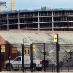 The University of Iowa Children's Hospital peers over Kinnick Stadium on Tuesday, Aug. 26, 2014.