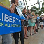 """Wednesday's kickoff rally drew about 200 people. Kelly Wilkinson / The Star photos People hold """"Liberty for all Hoosiers"""" signs at an event to launch the Freedom Indiana campaign that opposes HJR6, at the Artsgarden, Wednesday, August 21, 2013. Kelly Wilkinson / The Star"""