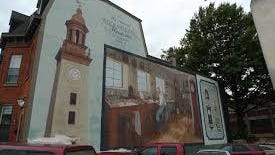 This mural points to clocks, a big thing in Columbia, home to the National Clock and Watch Museum.