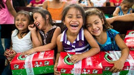 The boxes full of gifts of all sorts bring smiles to children's faces st Christmas.