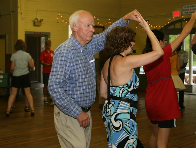 Swing dancers sway in step at this year's Swingin' Cayuga at Stewart Park on Sunday.