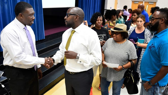 Metro Schools Director Shawn Joseph talks with Rob Merritt and other community members Tuesday, May 31, 2016, after a forum led by Joseph at Shayne Elementary School.